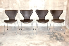 ARNE JACOBSEN Series 7 Chair, Model 3107, Set of 4 Mocha Aniline leather, chrome-plated steel, plastic Signed with molded manufacturer's mark to frame of each example- [Made in Denmark by Fritz Hansen] 79 x 51 x 47 cm RM 15,000 for a set of four